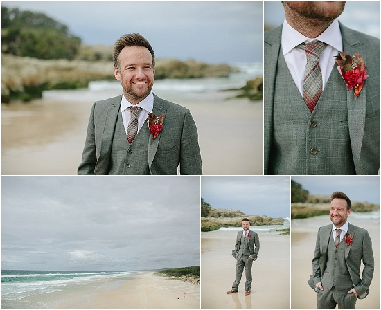 Alex stands in his groom suit on the beach
