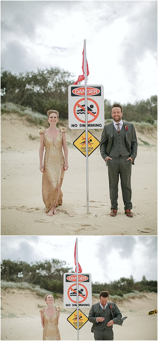 Bride and groom pose next to a no swimming sign on Australian beach