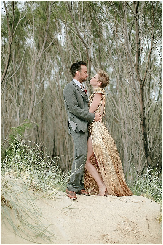 couple pose on a sand dune in Australia