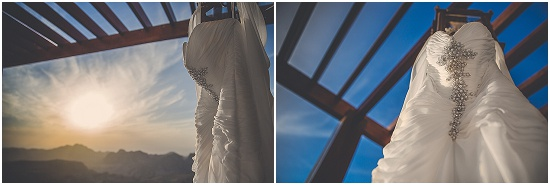 the bride has a white wedding dress to wear as well as a traditional Nabetean dress. the dress is hung for pictures