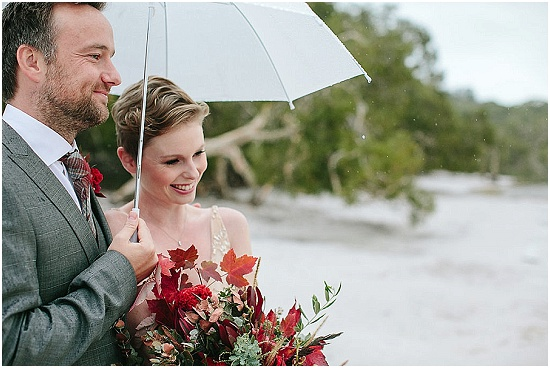a bride and groom exchange vows at  a wedding on stradbroke island