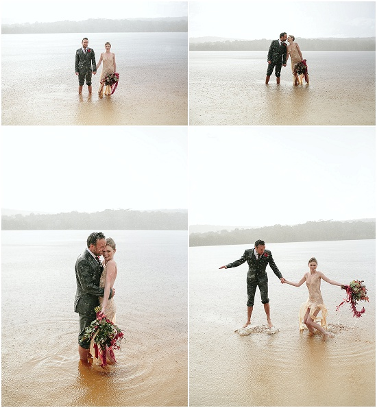 newly weds splash in the lake in a rain storm after a wedding on stradbroke island