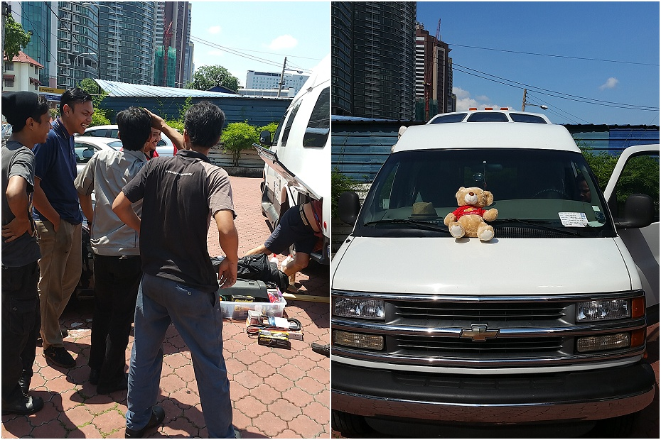 lots of mechanics crowd around Boris the campervan in Kuala Lumpur. They had never seen anything like it before
