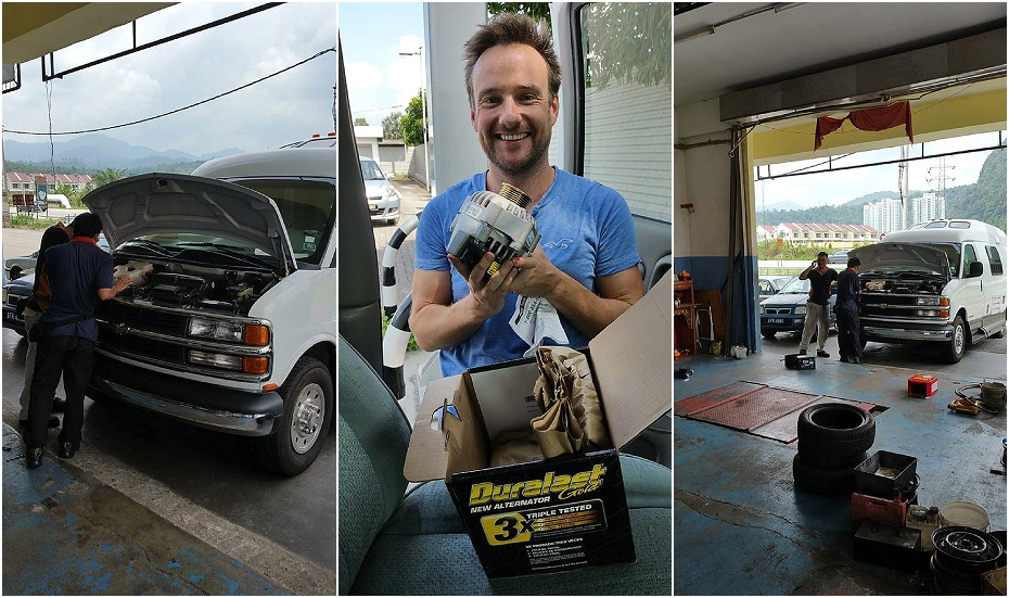 Alex holds a new alternator for Boris the campervan