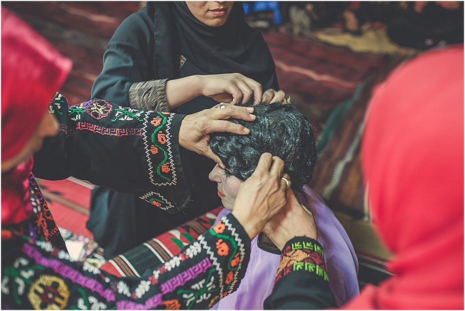 Lisas wig is adjusted by several women in preparation for the wedding in petra