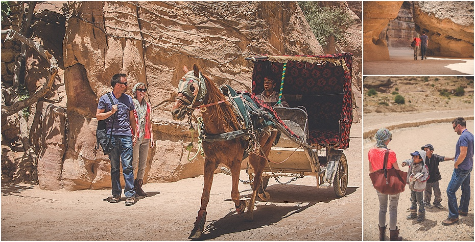 lisa & Alex stand back as a horse and cart speed past while they walk through the siq to Al Khazneh