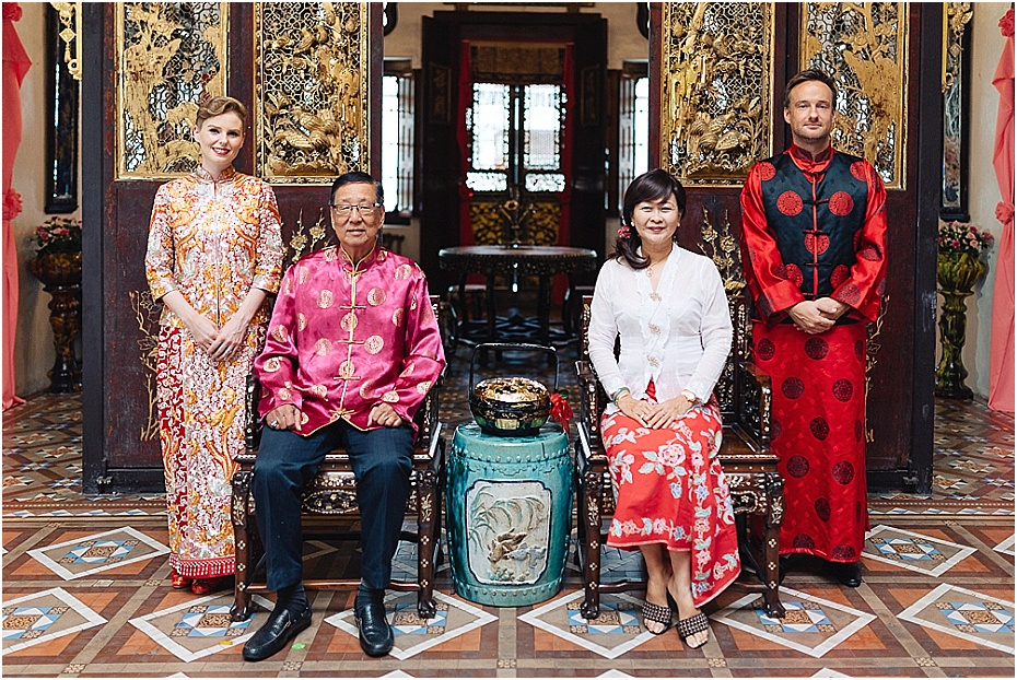 Bride And Groom Sit With Their Elders After The Chinese Tea Ceremony Wedding In Malaysia