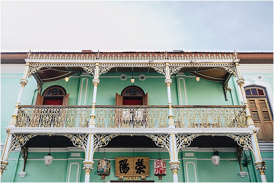 Pinang Peranakan Mansion front in mint green with original balconies