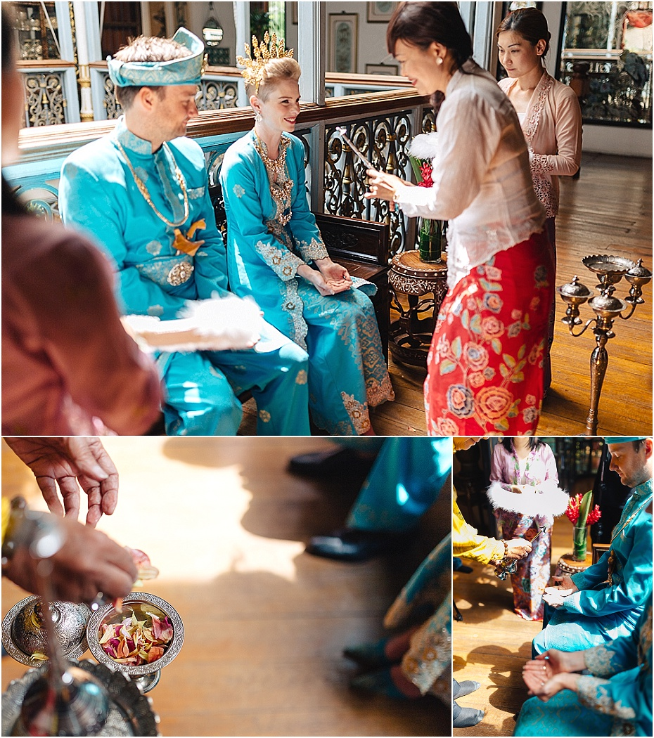 petals and rose water are sprinkled on the bride and groom as part of the traditional Malaysian wedding ceremony